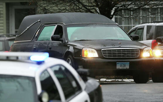 NEWTOWN, CT - DECEMBER 17:  The hearse carrying the body of 6-year-old Jack Pinto departs Honan Funeral Home following his funeral on December 17, 2012 in Newtown, Connecticut. Pinto was one of the 20 students killed in the Sandy Hook Elementary School mass shooting. Photo: Mario Tama, Getty Images / 2012 Getty Images