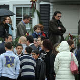 Mourners arrive at Honan Funeral Home, in Newtown, Conn., for the funeral of Jack Pinto, 6, on Dec. 17th, 2012. Pinto was one of 20 students killed at Sandy Hook Elementary School last Friday.