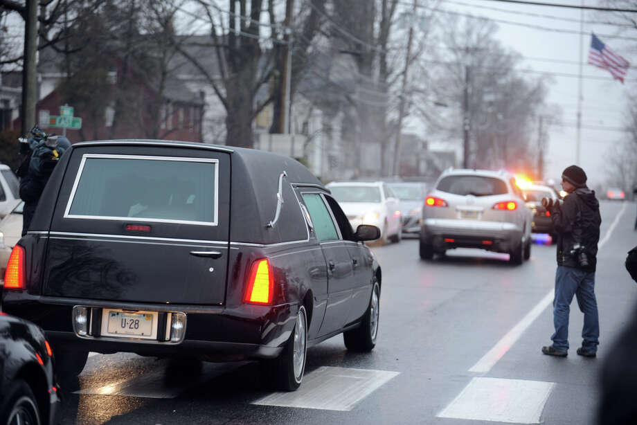 The hearse carrying Jack Pinto, 6, leaves Honan Funeral Home, in Newtown, Conn., in route to Newtown Village Cemetery during his funeral on Dec. 17th, 2012. Pinto was one of 20 students killed at Sandy Hook Elementary School last Friday. Photo: Ned Gerard / Connecticut Post