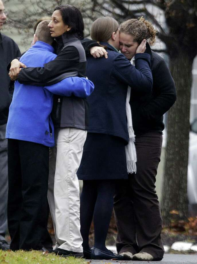 Mourners gather outside the funeral service of shooting victim, Jack Pinto, 6. The tragic killings have created momentum for examining gun and mental health laws, as well as the culture of violence.  Photo: David Goldman, Associated Press / AP
