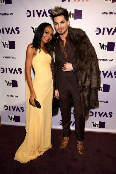 Singer/songwriter Malina Moye (L) and host Adam Lambert attend VH1 Divas 2012 at The Shrine Auditori