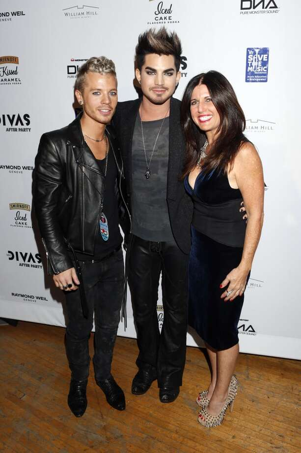 Adam Lambert (center) with Sauli Koskinen and mother Leila Lambert attend the VH1 Divas After Party to benefit VH1 Save the Music Foundation presented by William Hill Estate Winery, Raymond Weil and Monster DNA Headphones, on Sunday December 16, 2012 in Los Angeles. (Photo by Todd Williamson/Invision for VH1/ AP Images) (Associated Press)