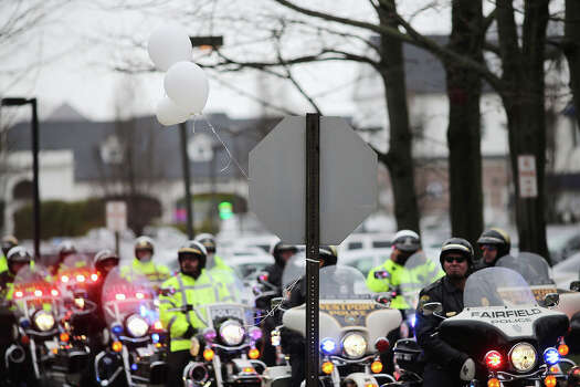 FAIRFIELD, CT - DECEMBER 17:  Police on motorcycles line the street following the funeral services for six year-old Noah Pozner, who was  killed in the shooting massacre in Newtown, CT, at Abraham L. Green and Son Funeral Home on December 17, 2012 in Fairfield, Connecticut. Today is the first day of funerals for some of the twenty children and seven adults who were killed by 20-year-old Adam Lanza on December 14, 2012. Photo: Spencer Platt, Getty Images / 2012 Getty Images