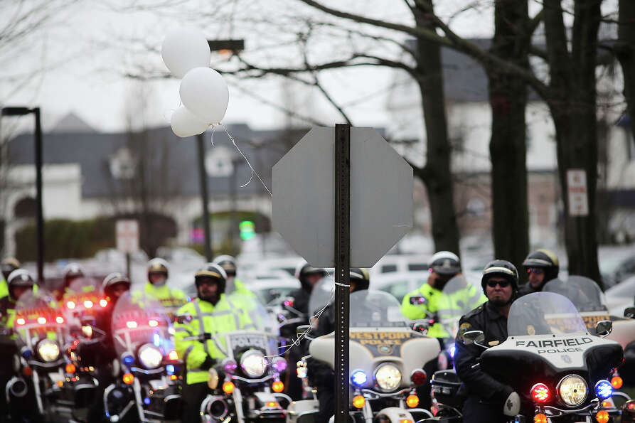 FAIRFIELD, CT - DECEMBER 17:  Police on motorcycles line the street following the funeral services f