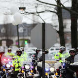 FAIRFIELD, CT - DECEMBER 17:  Police on motorcycles line the street following the funeral services for six year-old Noah Pozner, who was  killed in the shooting massacre in Newtown, CT, at Abraham L. Green and Son Funeral Home on December 17, 2012 in Fairfield, Connecticut. Today is the first day of funerals for some of the twenty children and seven adults who were killed by 20-year-old Adam Lanza on December 14, 2012.