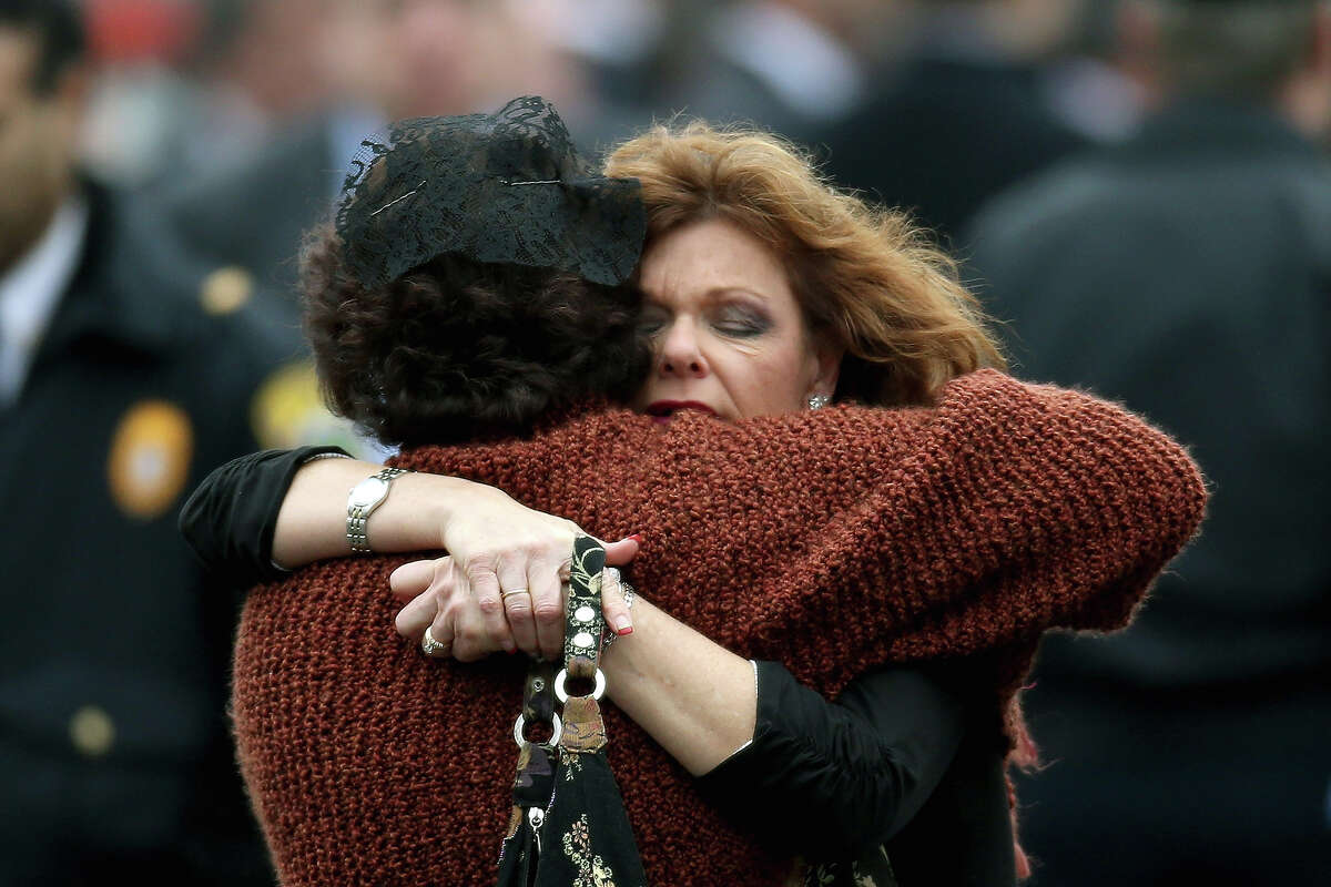 FAIRFIELD, CT - DECEMBER 17: Veronika Pozner (L) is hugged as she leaves the funeral services for her six year-old son Noah Pozner, who was killed in the shooting massacre in Newtown, CT, at Abraham L. Green and Son Funeral Home on December 17, 2012 in Fairfield, Connecticut. Today is the first day of funerals for some of the twenty children and seven adults who were killed by 20-year-old Adam Lanza on December 14, 2012.