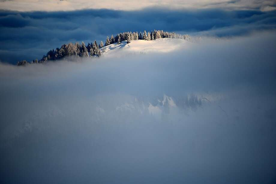 A break in the clouds: Fog partially covers Italy's Dolomites before the Men's World Cup Giant Slalom in Alta Badia. Photo: Olivier Morin, AFP/Getty Images