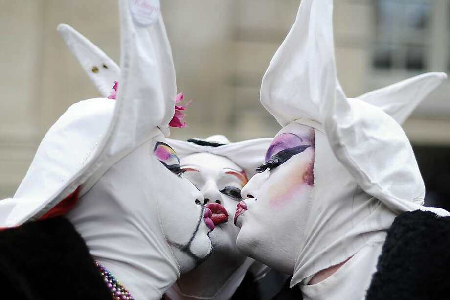 Are the Sisters of Perpetual Indulgence in Paris? Three nuns group-kiss in support of gay marriage and LGBT parenting in the City of Lights. Photo: Lionel Bonaventure, AFP/Getty Images