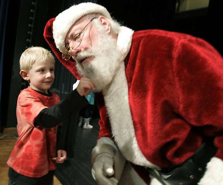 Actually I was looking for a photo ID, but OK: Santa lets 6-year-old Keton Sullivan tug on hi