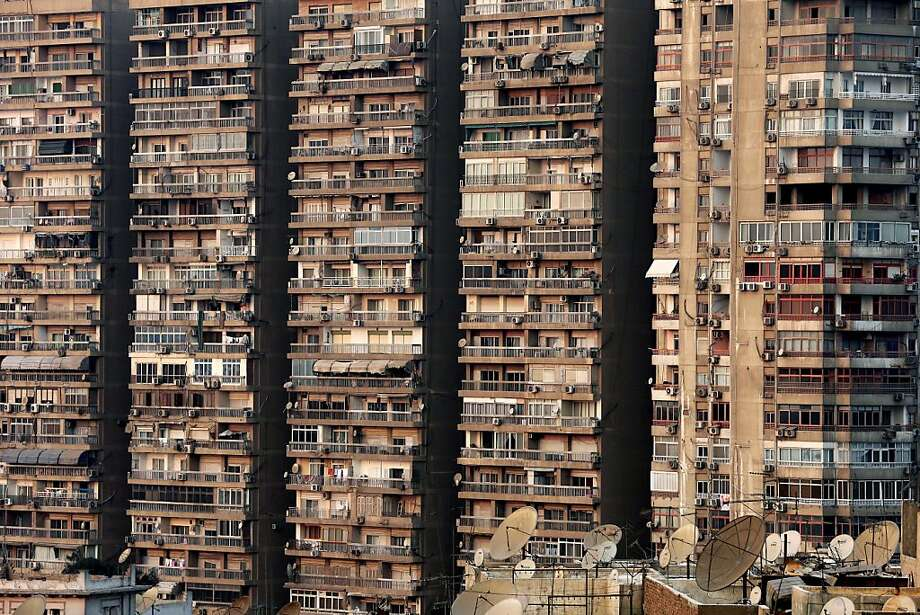 High-density residential: Scores of apartment units rise above the street in Cairo. Photo: Hassan Ammar, Associated Press