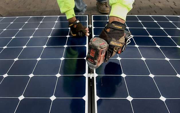 The state's largest utility firms will pass on about $1.3 billion in annual costs to people without solar systems. Photo: Sam Hodgson, Bloomberg