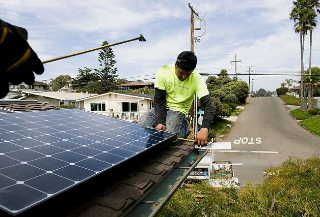 Juan Moedano, an installer with Stellar Solar, prepares the roof of a home for solar panel installation in Encinitas, California, U.S., on Wednesday, Aug. 15, 2012. Stellar Solar installs residential and commercial solar panels in the San Diego area. Photo: Sam Hodgson, Bloomberg