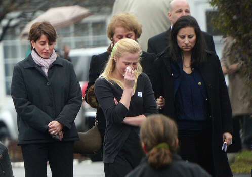 Mourners leave from Honan funeral home after attending the funeral for Jack Pinto, 6, one of the victims of the Sandy Hook elementary school shooting, on December 17, 2012, in Newtown, Connecticut. Funerals began in the little Connecticut town of Newtown after the school massacre that took the lives of 20 small children and six staff, triggering new momentum for a change to America's gun culture. AFP PHOTO/Emmanuel DUNAND Photo: EMMANUEL DUNAND, AFP/Getty Images / 2012 AFP