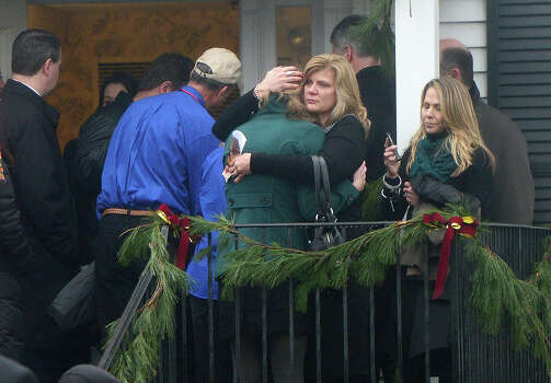 Mourners arrive at Honan funeral home to attend the funeral for Jack Pinto, 6, one of the victims of the Sandy Hook elementary school shooting, on December 17, 2012 in Newtown, Connecticut. Funerals began in the little Connecticut town of Newtown after the school massacre that took the lives of 20 small children and six staff, triggering new momentum for a change to America's gun culture.   AFP PHOTO/Emmanuel DUNAND Photo: EMMANUEL DUNAND, AFP/Getty Images / 2012 AFP