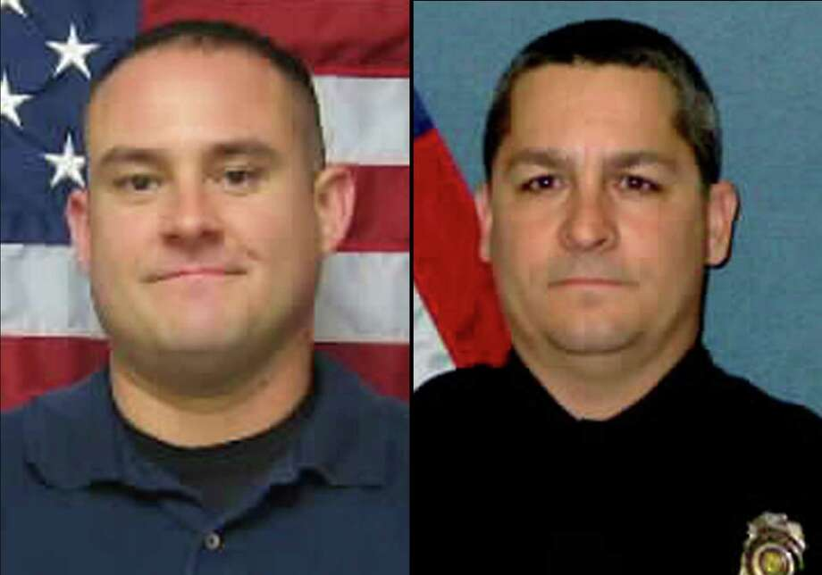 This combination of undated photos provided by the Topeka, Kan., Police Department shows Officer Jeff Atherly, left, 29, and Cpl. David Gogian, 50, who were fatally shot outside a Topeka grocery store Sunday, Dec. 16, 2012 while responding to a report of a suspicious vehicle, authorities said. Authorities say a man suspected in the fatal shooting of Atherly and Gogian has died after an armed standoff with law enforcement at a house in Topeka, Kan.  (AP Photo/Topeka Police Department) Photo: HOPD / Topeka Police Department