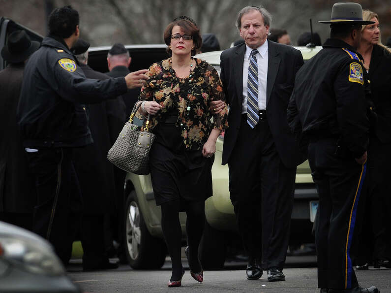 Veronika Pozner leaves the funeral for her six year-old son Noah Posner, killed in the mass shooting