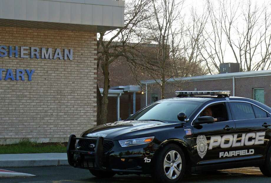 Schools will have an increased police presence and town officials will review all security systems and protocols for the school district in the wake of the shooting in Newtown. Photo: Genevieve Reilly / Fairfield Citizen