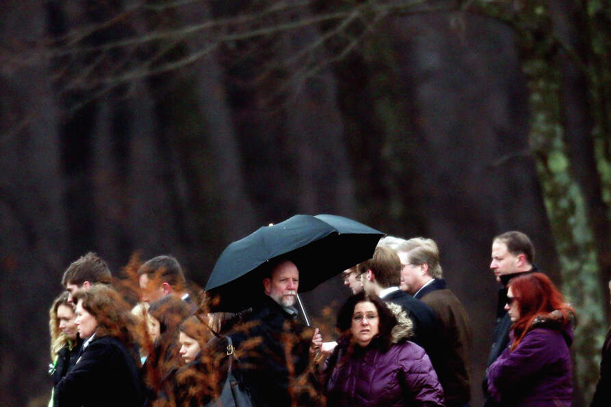 MONROE, CT - DECEMBER 17:  People attend the funeral services for six year-old Noah Pozner, who was