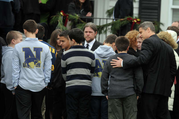 Mourners arrive at Honan Funeral Home, in Newtown, Conn., for the funeral of Jack Pinto, 6, on Dec. 17th, 2012. Pinto was one of 20 students killed at Sandy Hook Elementary School last Friday. Photo: Ned Gerard / Connecticut Post