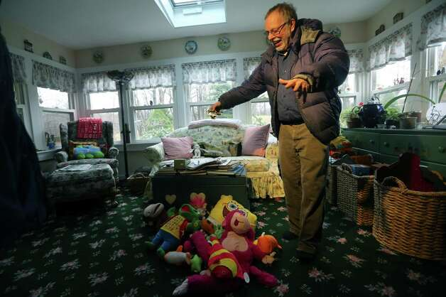 Gene Rosen shows some of the stuffed animals he entertained the children with during an interview with the Associated Press, Monday,Dec. 17, 2012 in Newtown, Conn. On the day of the shooting, Rosen took in four girls and two boys that were sitting at the end of his driveway; they had just run from the school, among the first to escape Friday's deadly shooting. He ran upstairs and grabbed an armful of stuffed animals he kept there. He gave those to the children, along with some fruit juice and sat with them as the two boys described seeing their teacher being shot. (AP Photo/Mary Altaffer) Photo: Associated Press