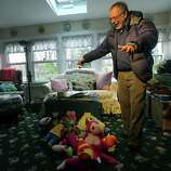 Gene Rosen shows some of the stuffed animals he entertained the children with during an interview with the Associated Press, Monday,Dec. 17, 2012 in Newtown, Conn. On the day of the shooting, Rosen took in four girls and two boys that were sitting at the end of his driveway; they had just run from the school, among the first to escape Friday's deadly shooting. He ran upstairs and grabbed an armful of stuffed animals he kept there. He gave those to the children, along with some fruit juice and sat with them as the two boys described seeing their teacher being shot. (AP Photo/Mary Altaffer)