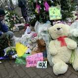 A]mourner pays his respects at one of the makeshift memorials for the Sandy Hook elementary shooting, Monday,Dec. 17, 2012 in Newtown, Conn. Authorities say a gunman killed his mother at their home and then opened fire inside the Sandy Hook Elementary School in Newtown, killing 26 people, including 20 children, before taking his own life, on Friday. (AP Photo/Mary Altaffer)