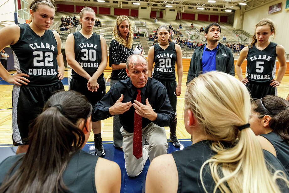 Clark girls basketball coach Richard Herbst talks to the Lady Cougars during a time out in their game with O'Connor at Paul Taylor Field House on Dec 4.  Photo by Marvin Pfeiffer / Northwest Weekly Photo: MARVIN PFEIFFER, Marvin Pfeiffer / Prime Time New / Prime Time Newspapers 2012