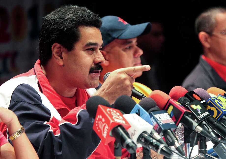 In this photo released by Miraflores Press Office, Venezuela's Vice-President Nicolas Maduro speaks during a news conference in Caracas, Venezuela, Sunday, Dec. 16, 2012. Venezuelans are choosing governors and state lawmakers in elections that have become a key test of whether President Hugo Chavez's movement can endure if the socialist leader leaves the political stage.  (AP Photo/Miraflores Press Office) Photo: HOPD / Miraflores Press Office