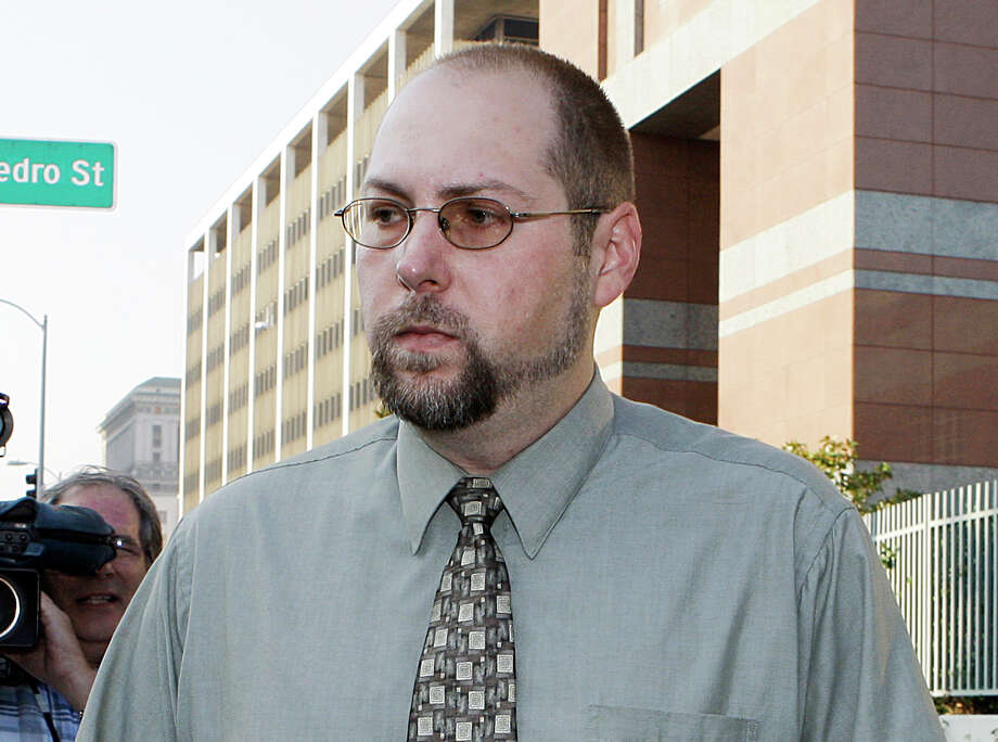 FILE - In this Nov. 1, 2011 file photo, Christopher Chaney, 35, of Jacksonville, Fla., leaves federal court in Los Angeles. Chaney has agreed to plead guilty to hacking into the email accounts of celebrities such as Christina Aguilera, Mila Kunis and Scarlett Johansson, whose nude photos eventually landed on the Internet, according to court documents filed Thursday, March 22, 2012.  Long before Christopher Chaney made headlines by hacking into the email accounts of such stars as Scarlett Johansson and Christina Aguilera, he honed his craft at the expense of two women who say he harassed them and stalked them online. (AP Photo/Reed Saxon, File) Photo: Reed Saxon