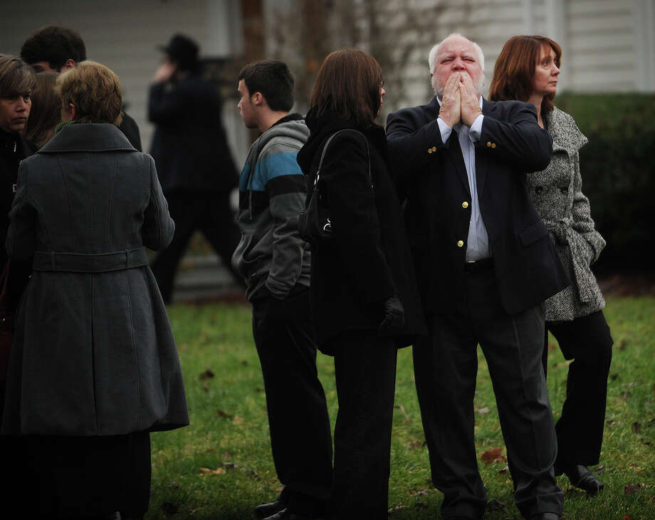 Mourners leave the funeral for her six year-old son Noah Posner, killed in the mass shooting at Sandy Hook Elementary School in Newtown, at the Abraham L. Green Funeral home in Fairfield on Monday, December 17, 2012. Photo: Brian A. Pounds / Connecticut Post