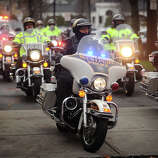 A procession of police motorcycles from area departments leads the funeral procession for her six year-old son Noah Posner, killed in the mass shooting at Sandy Hook Elementary School in Newtown, from the Abraham L. Green Funeral home in Fairfield on Monday, December 17, 2012.