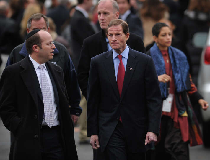 Senator Richard Blumenthal, right, leaves the funeral for her six year-old son Noah Posner, killed i