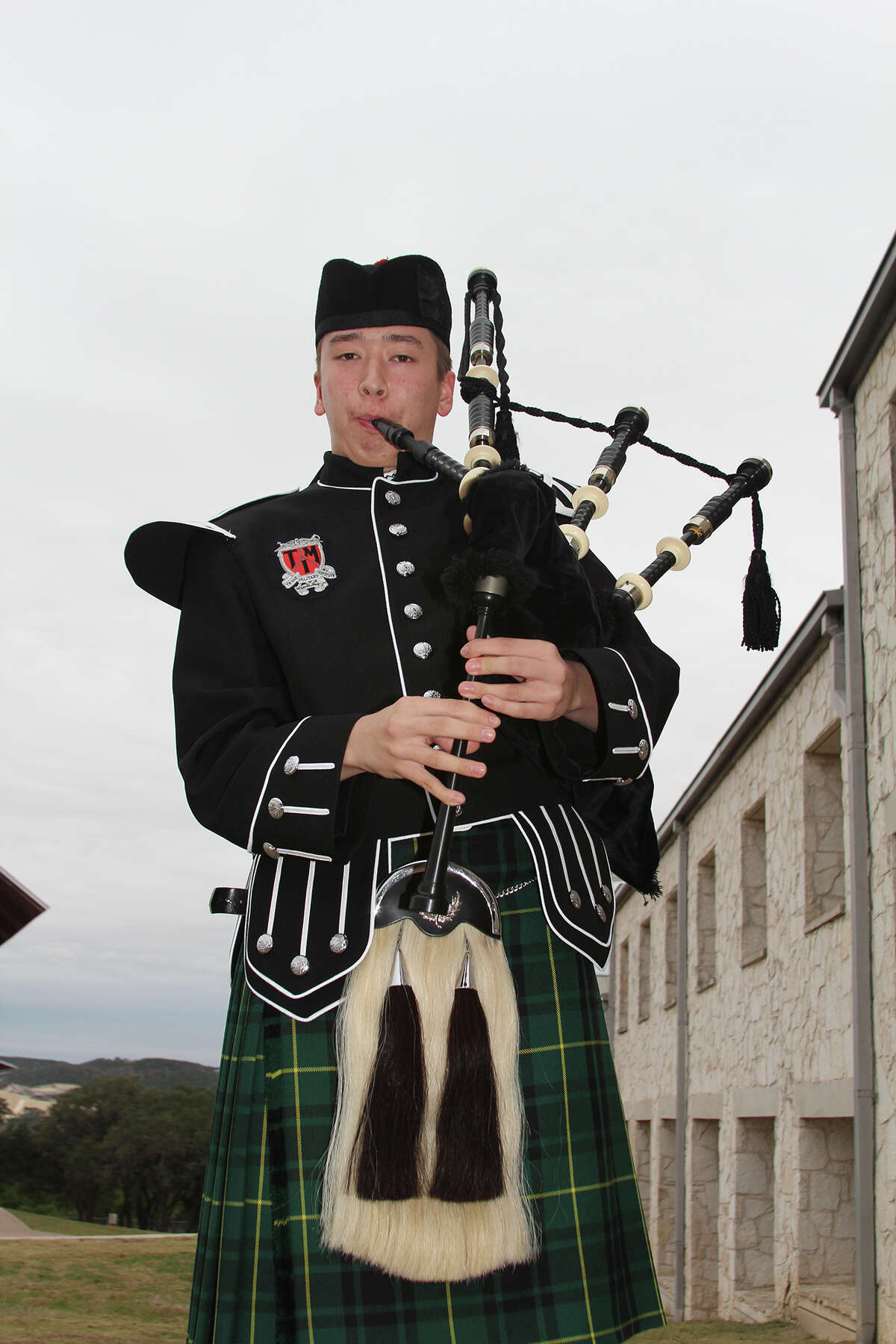 Lincoln Abbott, a freshman at TMI-The Episcopal School, became entranced with the bagpipes when he sighted players in the Boerne Weihnachts Parade six years ago. His skill level has brought him recent awards.