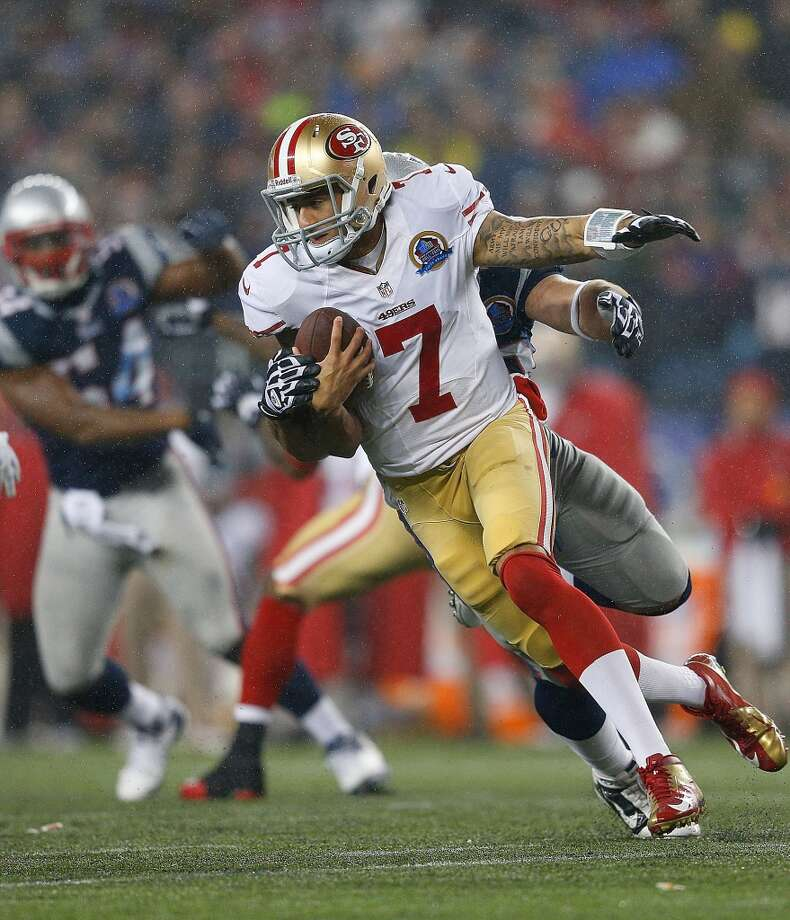 Colin Kaepernick #7 of the San Francisco 49ers feels the pressure of Rob Ninkovich #50 of the New England Patriots in the second half at Gillette Stadium on December 16, 2012 in Foxboro, Massachusetts.  (Jim Rogash / Getty Images)