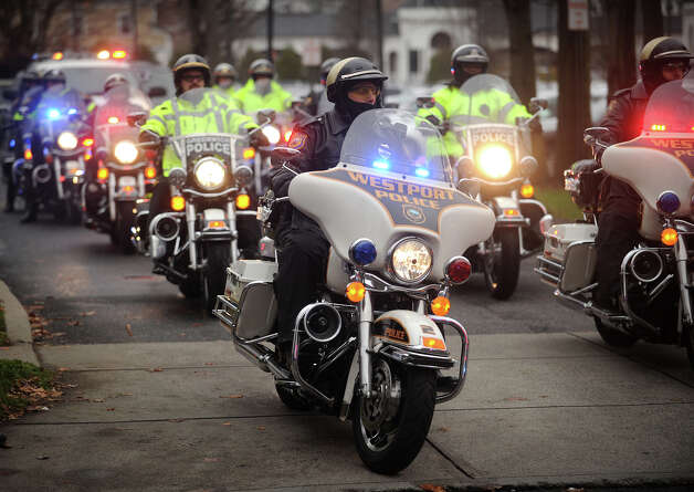 A procession of police motorcycles from area departments leads the funeral procession for her six year-old son Noah Pozner, killed in the mass shooting at Sandy Hook Elementary School in Newtown, from the Abraham L. Green Funeral home in Fairfield on Monday, December 17, 2012. Photo: Brian A. Pounds / Connecticut Post