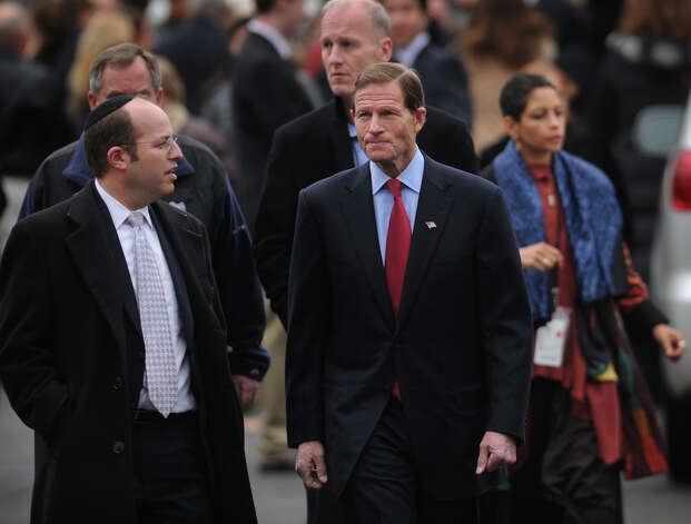 Senator Richard Blumenthal, right, leaves the funeral for her six year-old son Noah Pozner, killed in the mass shooting at Sandy Hook Elementary School in Newtown, at the Abraham L. Green Funeral home in Fairfield on Monday, December 17, 2012. Photo: Brian A. Pounds / Connecticut Post