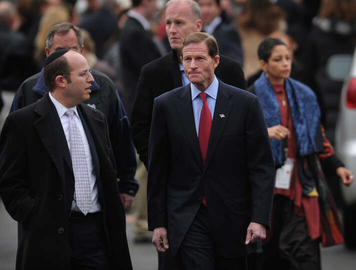 Senator Richard Blumenthal, right, leaves the funeral for her six year-old son Noah Pozner, killed i