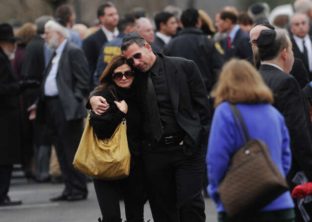 Mourners leave the funeral for her six year-old son Noah Pozner, killed in the mass shooting at Sandy Hook Elementary School in Newtown, at the Abraham L. Green Funeral home in Fairfield on Monday, December 17, 2012. Photo: Brian A. Pounds / Connecticut Post