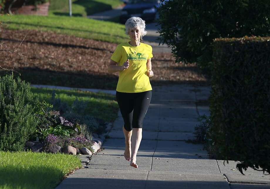 Hetherington runs shoeless through her neighborhood, a practice she says has improved her form. Photo: Paul Chinn, The Chronicle
