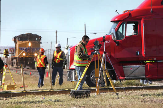 Crime scene technicians gather data during a staging of the Nov. 15 train wreck that killed four while riding on a parade float that was struck by a freight train in Midland, TX, Monday, Dec. 17, 2012. Photo: Bob Owen, San Antonio Express-News / © 2012 San Antonio Express-News
