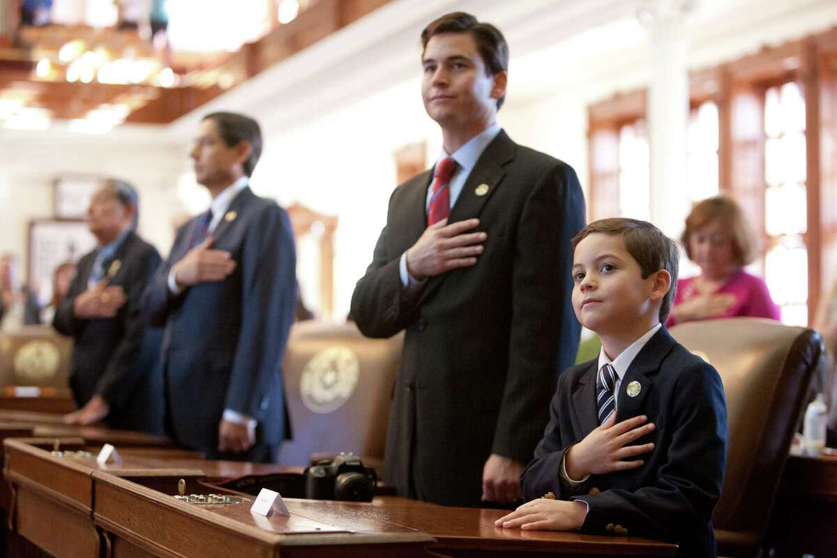 (Right to left) Roy Barrera IV, Roy Barrera III, Roy Barrera Jr., and Roy Barrera Sr. plesge allegiance to the Texas flag at the state capitol in Austin on Monday December 17, 2012. The Barrera family members were present for Texas Secretary of State John Steen's first official duty as he presides over the state's electoral college vote.