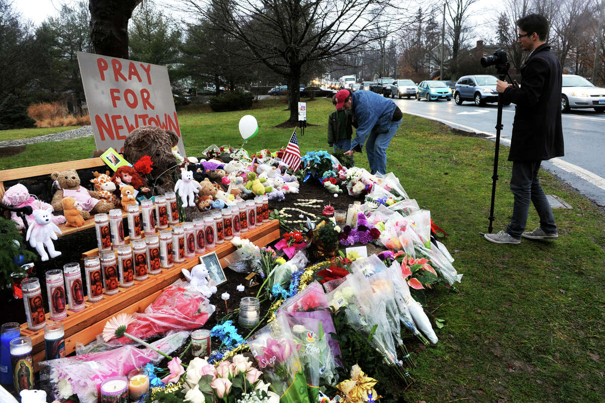 A memorial filled with flowers, candles and stuffed animals has been set up on The PLeasance, a town park on Main Street, in Newtown, Conn., Dec. 17th, 2012. Monday was the first day of funerals for victims of the Sandy Hook Elementary School shootings last Friday.