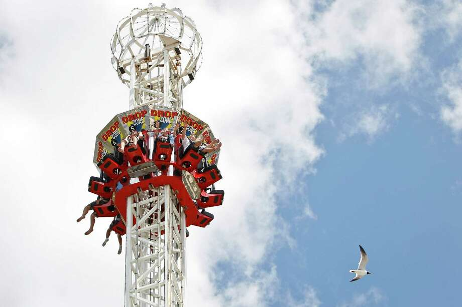 Thrill-seekers ride the Drop Zone at the Kemah Boardwalk, Monday, June 20, 2011, in Kemah.  ( Michael Paulsen / Houston Chronicle ) Photo: Michael Paulsen, Staff / © 2011 Houston Chronicle