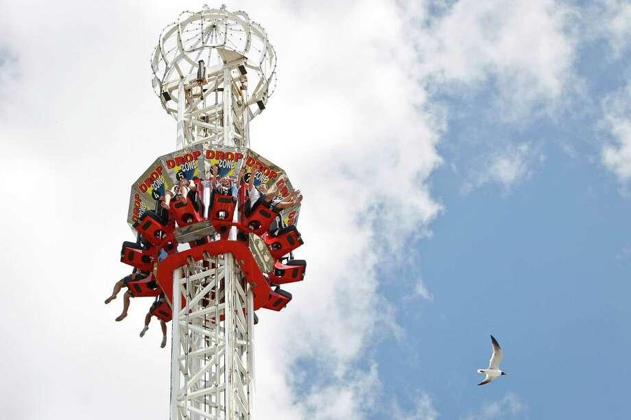 Thrill-seekers ride the Drop Zone at the Kemah Boardwalk, Monday, June 20, 2011, in Kemah.  ( Michael Paulsen / Houston Chronicle ) Photo: Michael Paulsen, Staff / © 2011 Houston Chronicle