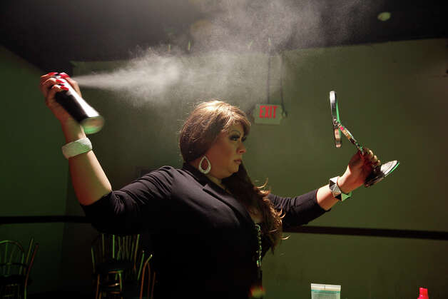 Jenni Rivera impersonator Odalis Aranjin, 33, gets ready before performing Friday Dec. 14, 2012 at El Fuerte. Photo: Edward A. Ornelas, San Antonio Express-News / © 2012 San Antonio Express-News