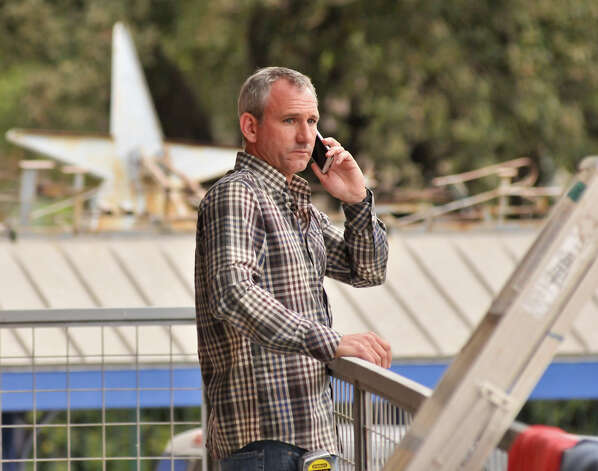 Restauranteur John Long talks on the phone while overseeing renovation to a space in the Blue Star Complex. He plans to open a new restaurant in the complex named Halcyon. Photo: For The Express-News