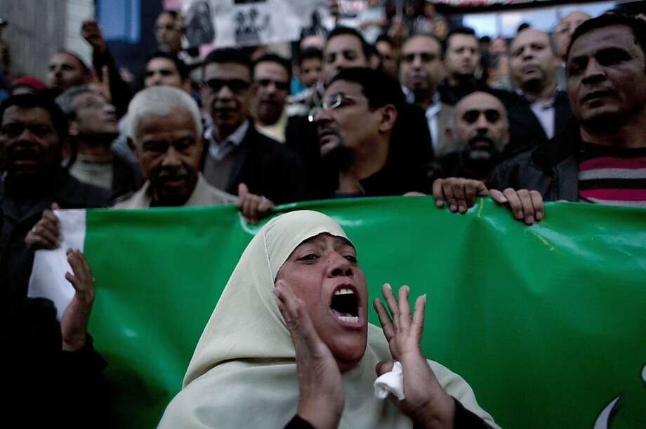 An Egyptian woman chant slogans denouncing President Mohammed Morsi during a protest supporting the Wafd party, in Cairo, Egypt, Monday, Dec. 17, 2012. A mob of hardline Islamists known as Salafis attacked the Cairo offices of the liberal Wafd party, smashing windows and doors last week. Photo: Nasser Nasser, Associated Press