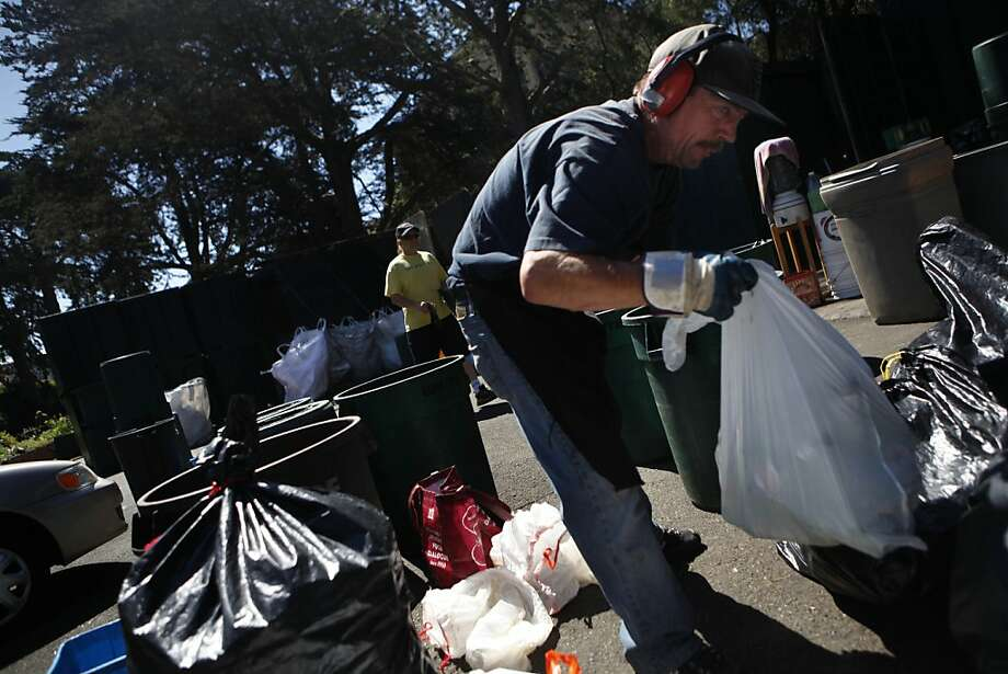 There's an eviction notice posted, but no move to follow through. Here Nick Baffi sorts recyclables at the center. Photo: Lea Suzuki, The Chronicle