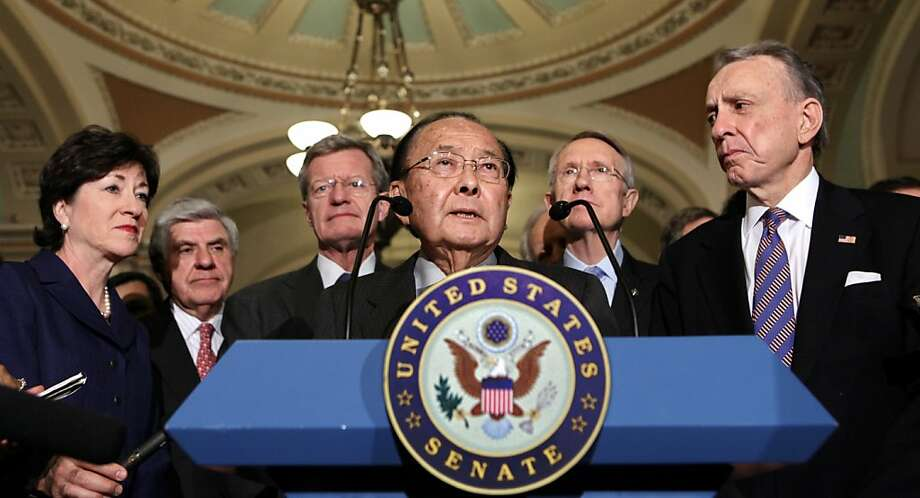 Democratic Sen. Daniel Inouye (center) had a reputation for bipartisanship that gained him respect and influence with colleagues of both political parties. Photo: J. Scott Applewhite, Associated Press