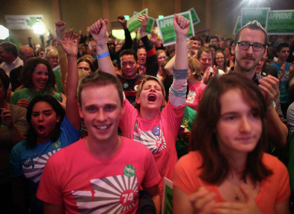 November 6, 2012 - People celebrate as the initial returns for Referendum 74 come in during an election night party at the Westin Hotel. The referendum, approved by voters, made same-sex marriage legal in Washington State. Voters also approved a measure to legalize small amounts of marijuana for recreational use. The election results hinted at a significant shift in the public's stance on certain social issues in Washington State. Story here.